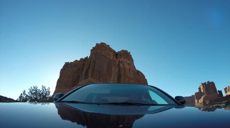 drive : A car driving through Arches National Park at Sunsrise