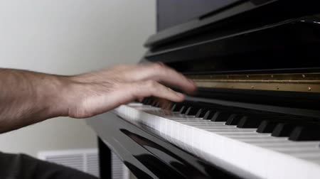 пианино : A man plays jazz on the black piano in his house