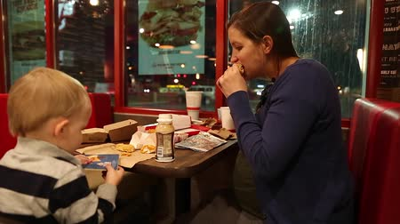 szalma : a young family eating at a fast food restaurant