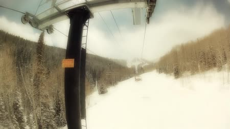 chair lift : downhill skiing at a beautiful mountain resort after a snow storm