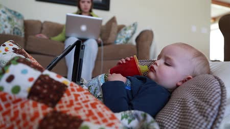a toddler sick with a flu watching tablet near mother Stock Footage