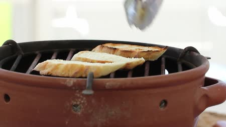 bruschetta : a woman grills baguettes for fresh bruschetta