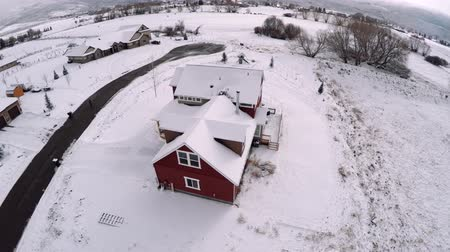 имущество : an aerial view of a country house after a snow storm