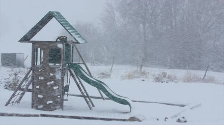 plac zabaw : An empty playground in a winter blizzard