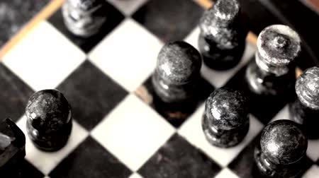 estratégico : Playing with a beautiful marble chess set.  Dolly Shot Stock Footage