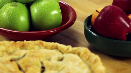 crust : a woman baking a delicious apple pie for dessert in her home kitchen
