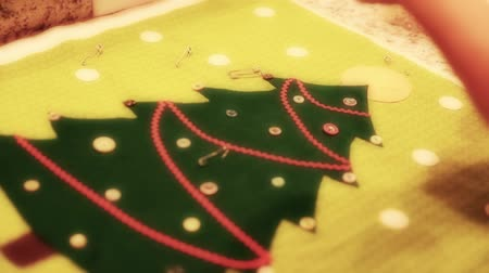 szycie : a woman sewing a christmas advent calendar
