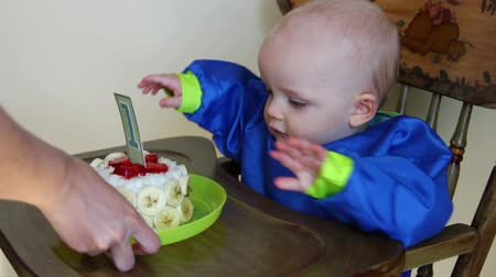 baby boy having 1st birthday Stock Footage