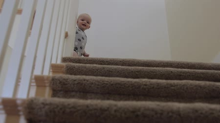 baby boy playing on the stairs