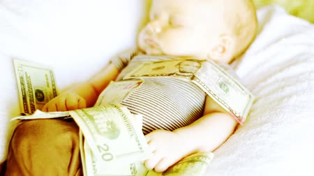 pieniądze : Baby with money on him