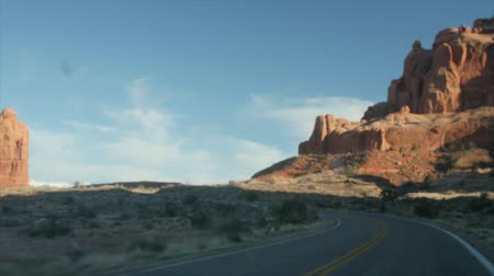 sál : Car driving through scenic arches national park Utah Stock mozgókép