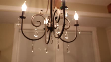 dekoracje : a dolly shot of a beautiful chandelier in the home dining room