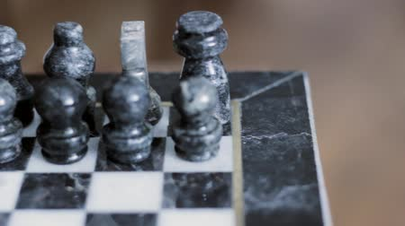 konkurenční : Playing with a beautiful marble chess set.  Dolly Shot Dostupné videozáznamy