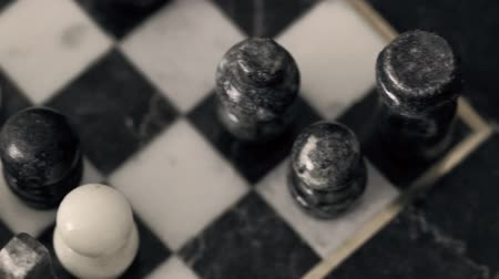 rytíř : Playing with a beautiful marble chess set.  Dolly Shot Dostupné videozáznamy