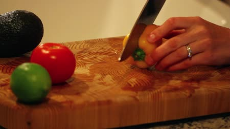 chop up : chopping yellow pepper for salad