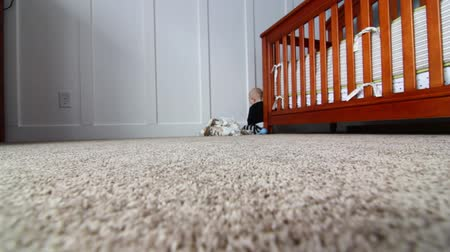pisos : a baby plays by his crib Stock Footage