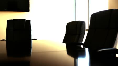 sala konferencyjna : dolly shot of chairs at the conference room