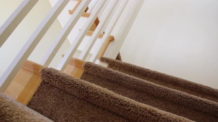 halı : Dolly shot of stairs in a new home