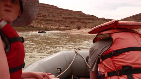 families floating down a desert river Stock Footage