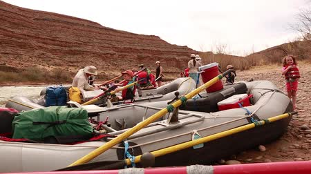 ток : river rafts floating down the san juan river in southern utah