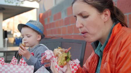 fry : Family eating fast food for dinner outside diner