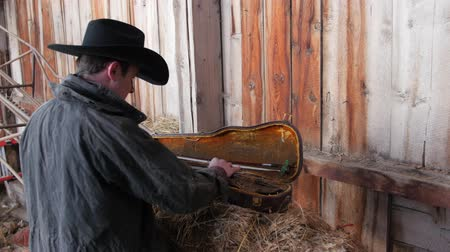 buty : Cowboy finds a fiddle in his old barn
