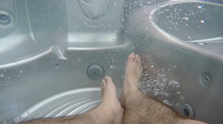 küvet : feet in the hot tub with bubbles