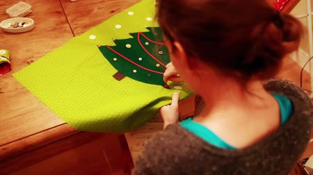to celebrate : female sewing a advent calendar