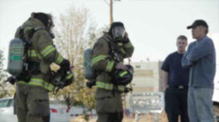 auxiliar : firefighters putting out a fire at a warehouse Stock Footage