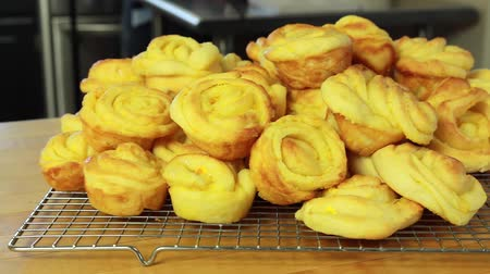 descamação : fresh baked orange rolls on the counter