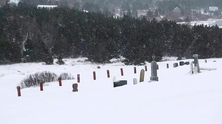 gravestone : graveyard in huge winter storm