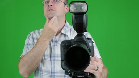 přední : A green screen shot of a photographer taking pictures in his studio