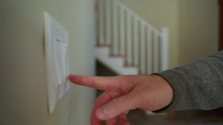 interruptor : hand touching the light switches