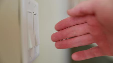 comutar : hand using light switches Stock Footage