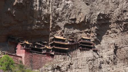 budha : hanging temple at datong china with tourists