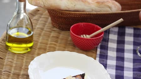 bruschetta : homemade italian bruschetta on the kitchen table Stock Footage