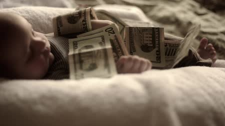 yirmi : Little baby with pile of money