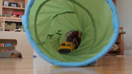 tüpler : A little boy toddler plays inside a play tunnel in the living room