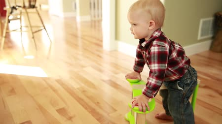 kordé : a little baby boy playing with a push toy