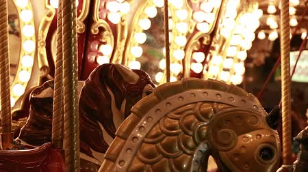 yuvarlak : loading a merry go round at night time Stok Video
