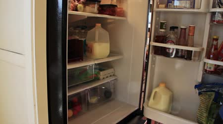 frigorífico : A man takes milk out of the fridge Stock Footage