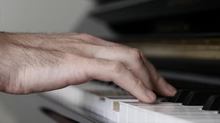 enstrüman : Man playing classical on a piano inside his home Stok Video