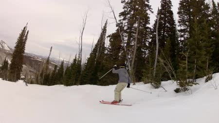 kask : man sking off a jump at a mountain resort slow motion