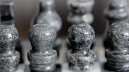 estratégico : Marble Chess Pieces Dolly Shot Stock Footage