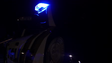 syrena : Police car lights at an accident scene at night tilting shot