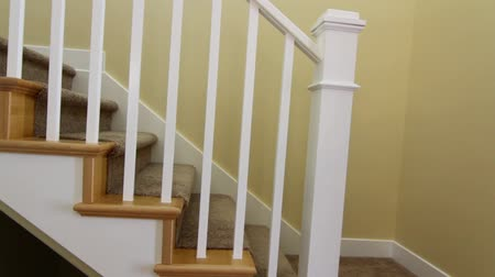 homes : jib shot of stairwell Stock Footage