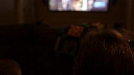 watching : Kids watch movie in a home theater entertainment room