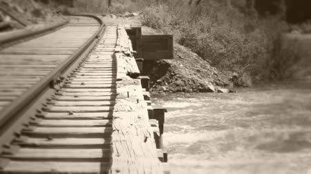 Old railroad bridge and river dolly shot