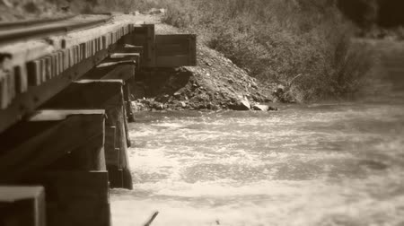 runoff water : Old train bridge over flooding river Stock Footage