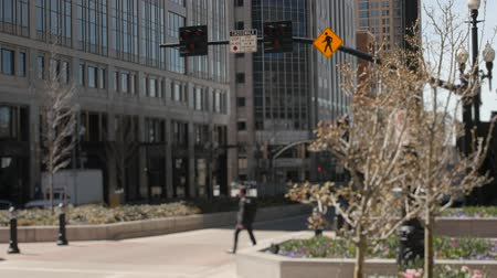 kural : Pedestrians walk through a cross walk in downtown Salt Lake City Utah